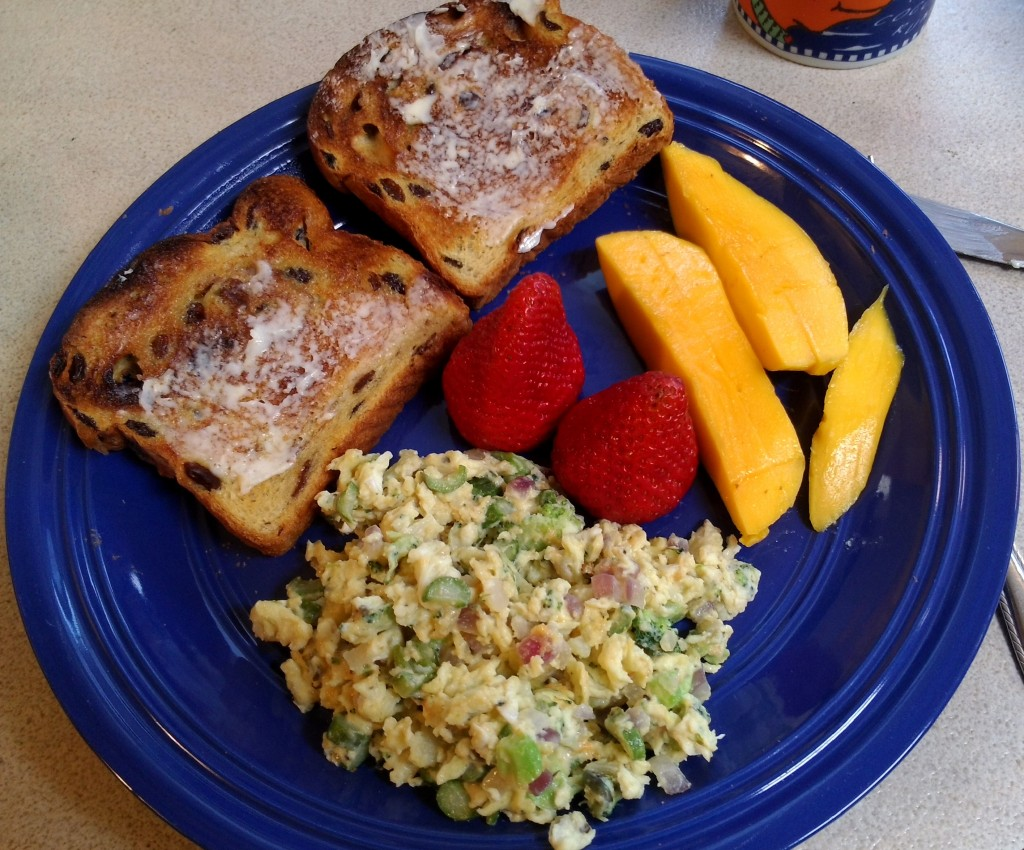 Brunch - eggs scramble with veg, toast, mangoes and strawberries.