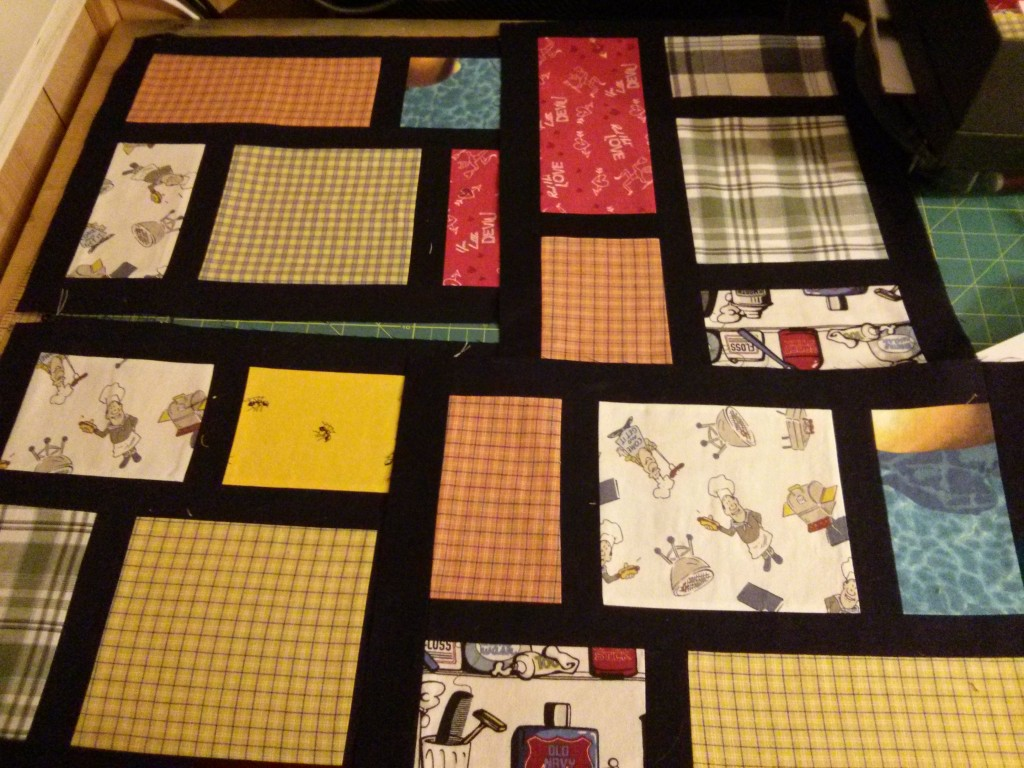 Boxer quilt first four blocks completed.